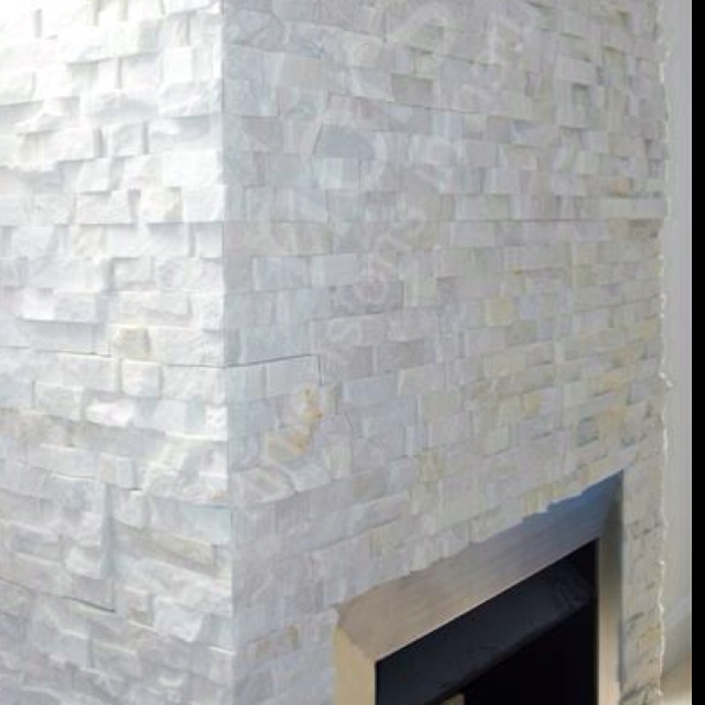 Decided I want to do chocolate walls with a white stone fireplace wall all the way to the ceiling.