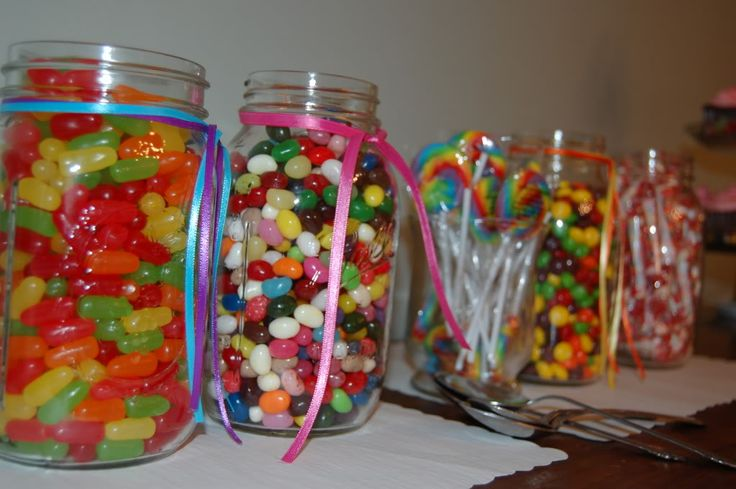 Mason Jars filled with candy - an idea for Sweet 16. Each girl could make their own treat bag.