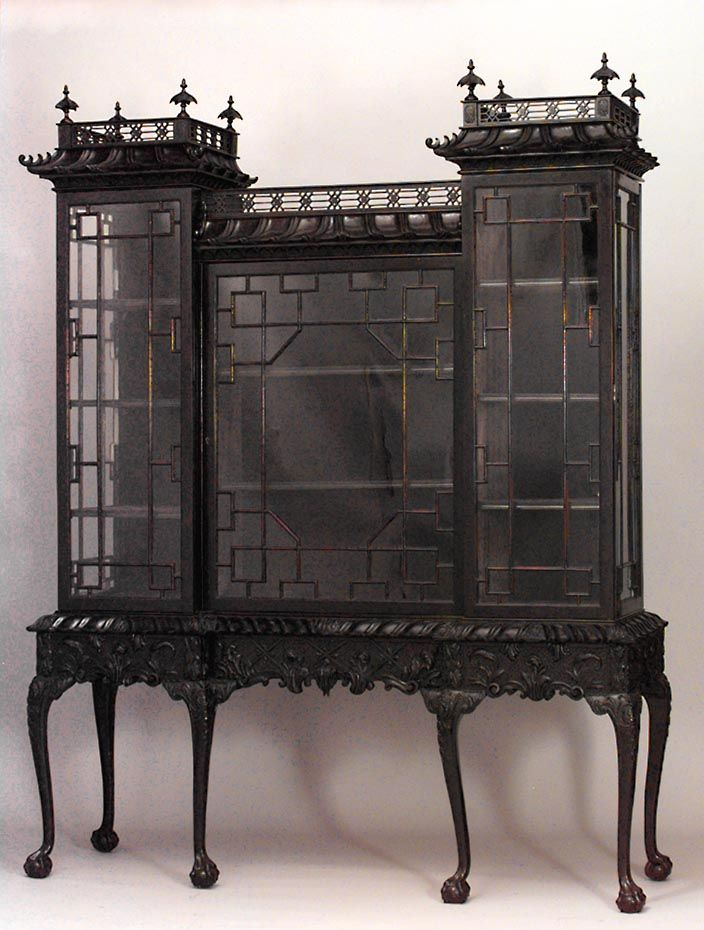 English Chinese Chippendale style mahogany display cabinet on stand with fretwork & pagoda gallery above 3 glazed doors on cabriole legs with claw & ball feet (early 20th Cent)