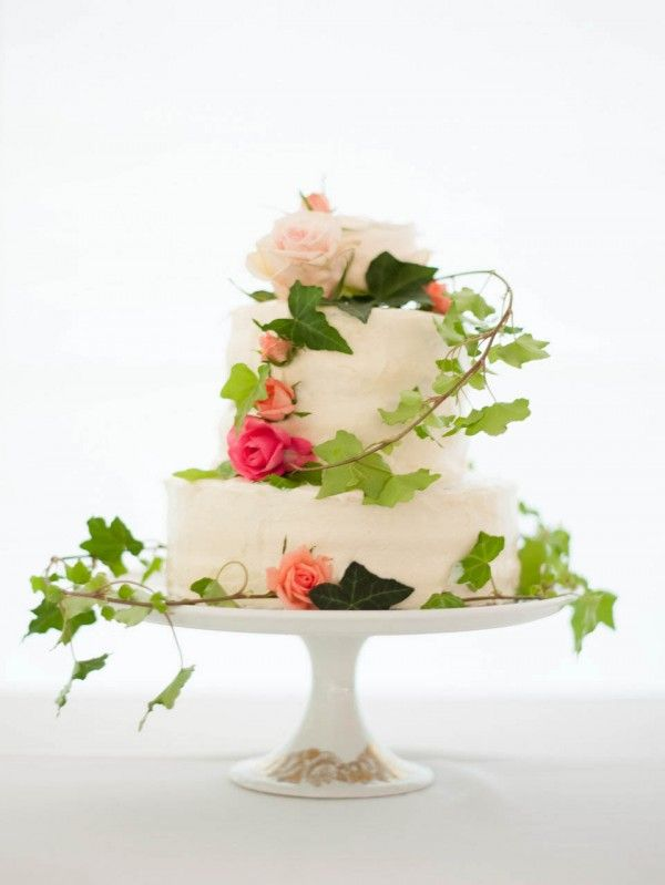 Fresh and floral and finished off with leafy vines this is a simply lovely cake.