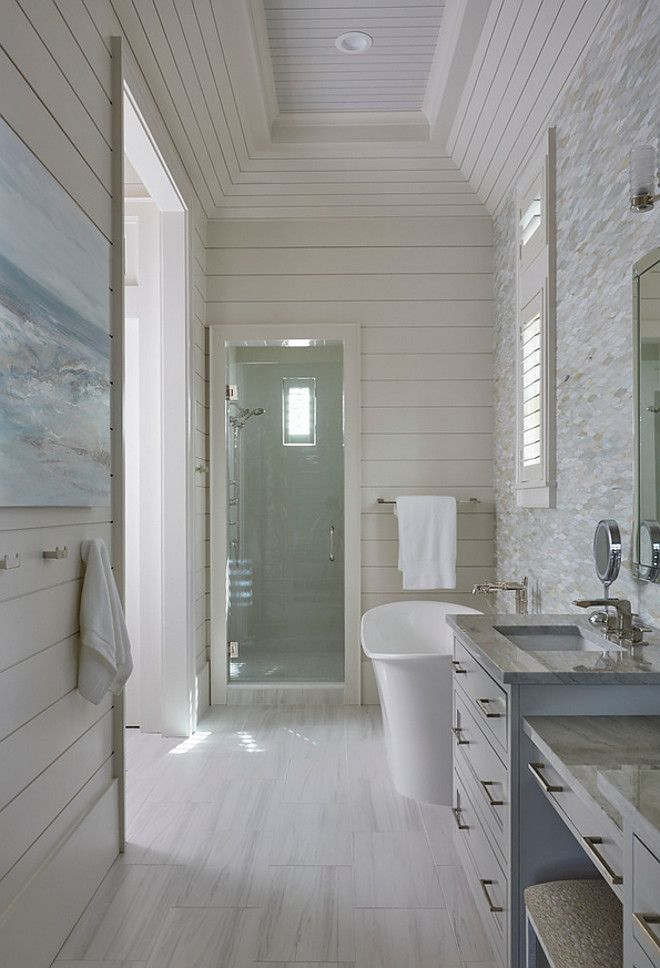 The master bathroom also features a rectangular tray ceiling accented with shiplap trim.