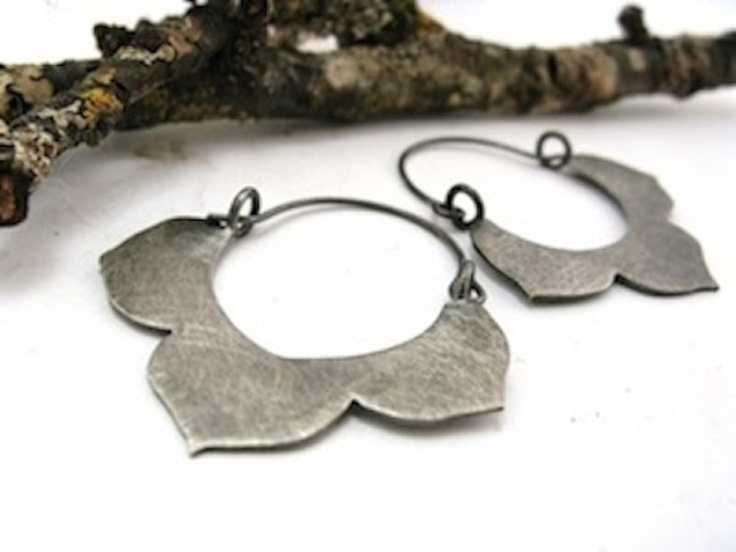 These hoops are hand cut from sterling silver sheet. The flowers design is based on the kikyo, or Japanese bellflower. Earrings measure approximately 1 3/4 inches long and are 1 1/2 inches across at their widest point. The earrings have been given a lovely black patina and then buffed back with a steel brush for an organic scratched surface. $62