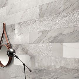 Italgraniti White Experience More Than Marble The infinite seduction of white acquires new dimensions: Unusual, surprising surfaces, maxi-sizes and decorat