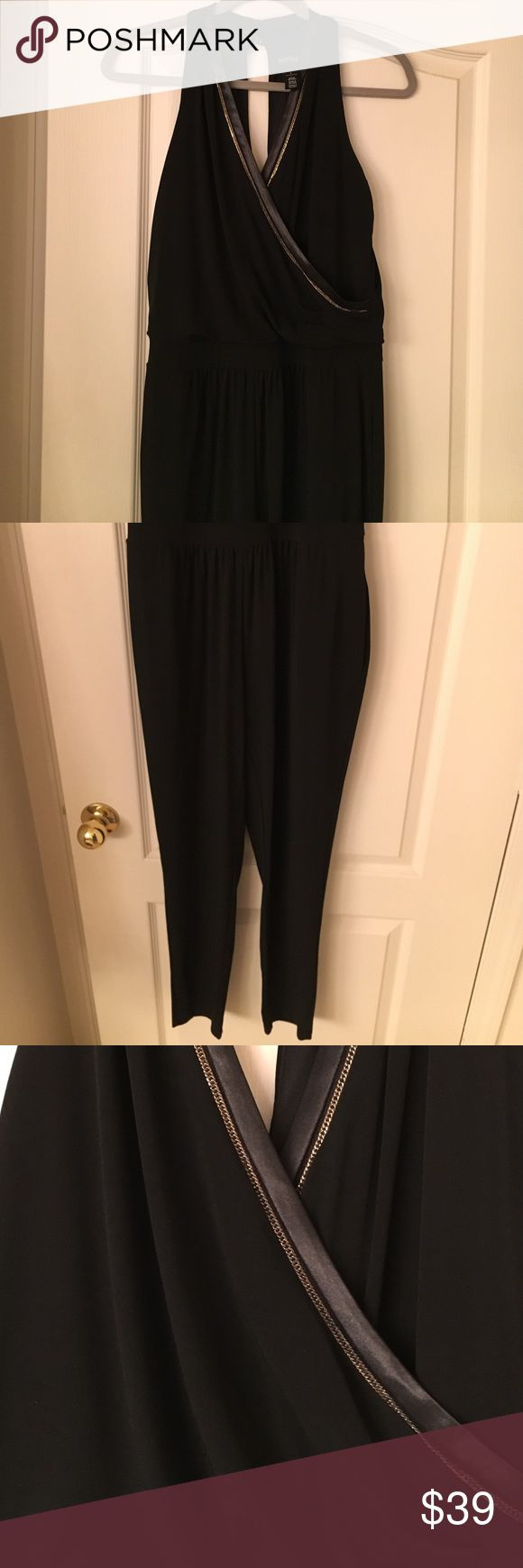 """Black halter jumpsuit WHBM halter jumpsuit.  Pockets, v neck with gold trim.  Size 2.  Legs taper at bottom.  I'm 5'4"""" and length is perfect to wear with heels or dressy flip flops.  Never worn. White House Black Market Other"""