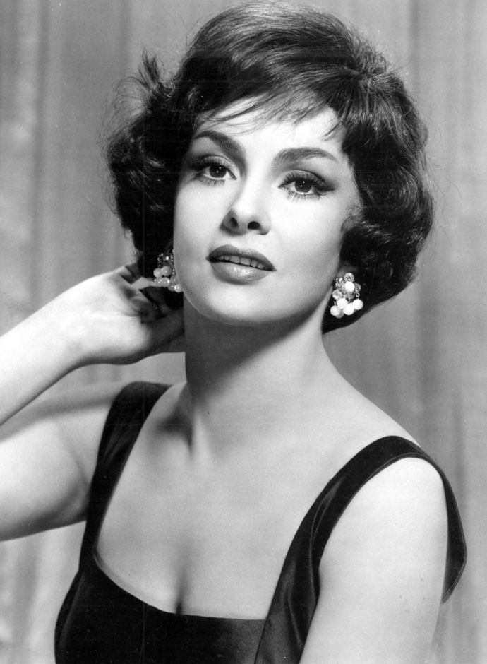 "20 Best Italian Actresses: Gina Lollobrigida (1927) - Luigina ""Gina"" Lollobrigida is an Italian actress, photojournalist and sculptor. She was one of the most popular European actresses of the 1950s and early 1960s, when she was also considered a sex symbol. She received numerous awards and nominations for her performances in Italian and American films, working with many stars of Hollywood. In 1950, Howard Hughes invited Lollobrigida to make Hollywood films, but she refused, preferring to…"