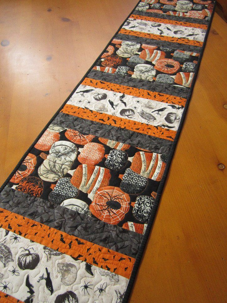 Halloween Quilted Table Runner with Pumpkin, Bats and Crows by patchworkmountain.com