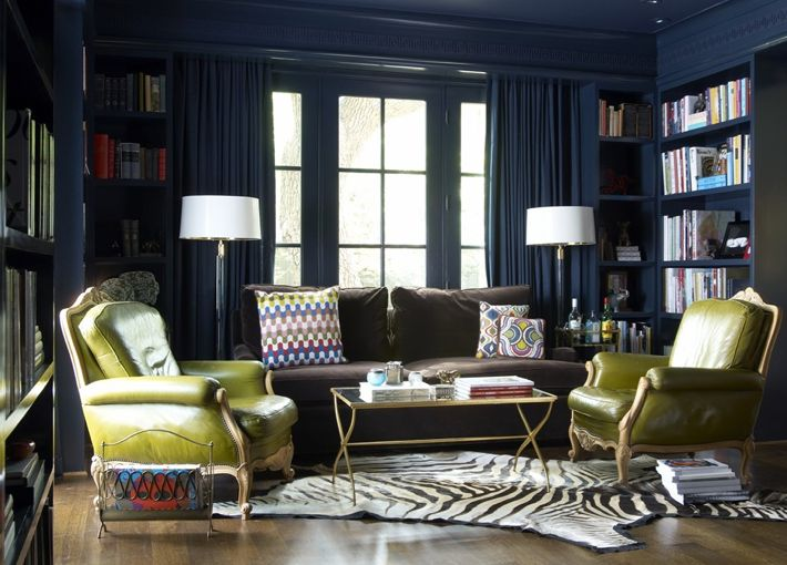 Blue lime green eclectic library office design with bold peacock blue teal glossy walls paint for Dark blue walls in living room