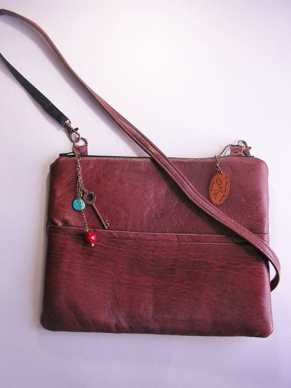 Leather ipad sleeve, bag, purse with pocket and shoulder strap.