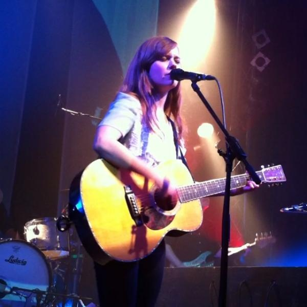Marit Larsen playing an acoustic guitar in Hamburg Germany 4/18/2012