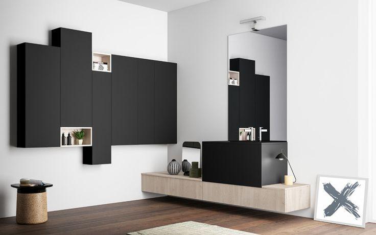 Progetto 2: anche in bagno gli stessi materiali di cucina e living, il Fenix NTM® nero ed il Legno Nordico Luce in contrasto colore e giochi di posizioni sfalsate. Un elegante mix tra minimalismo e calore domestico.