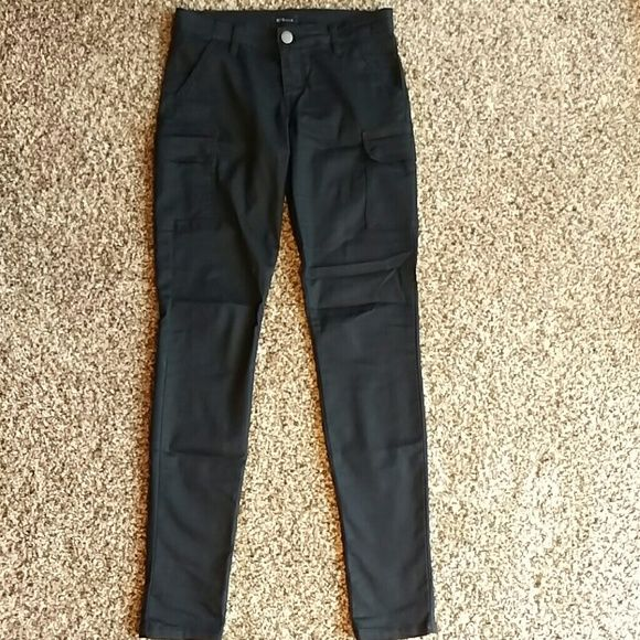 Black skinny cargo pants Black skinny cargo pants. In excellent condition-purchased at Nordstrom Rack. They contain 38% polyester so they won't fade and 2% spandex to allow for a little stretch. I was only able to wear these a few times before losing weight. Now all they need is a good new home! STS Blue   Pants