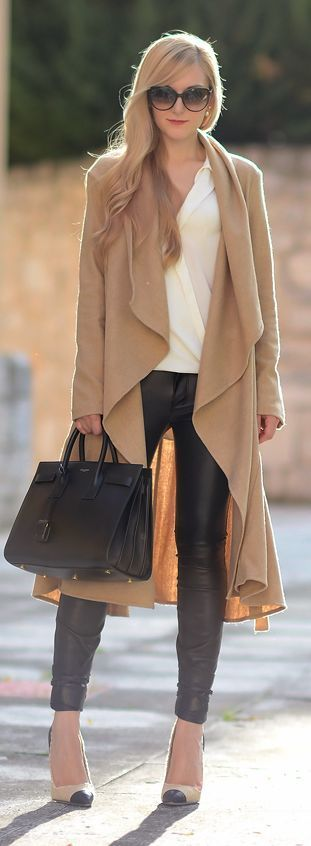 black leggings and a big neutral wrap.