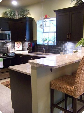 dark kitchen cabinets gray backsplash and the light version of the chairs we want from Target