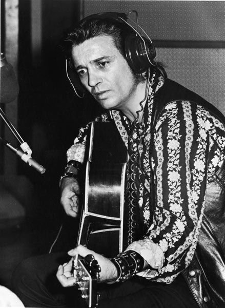 Country Music 1960s | Country musician Waylon Jennings records a song in a recording studio ...