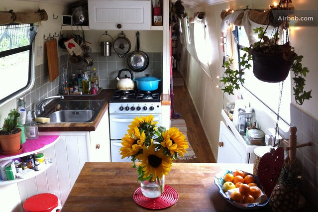 Like the pos and pans, and the tiles in the kitchen space - Beautiful 2 bedroom narrowboat in London