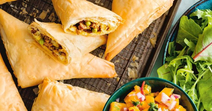 Add some spice to your weeknights with these crispy lamb samosas served with a sweet and spicy mango salsa.