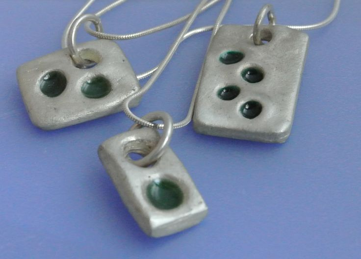 Sterling silver, and cold enamel
