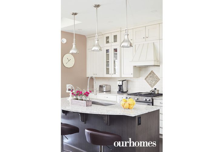 """The homeowners love to entertain. Cooking and socializing happen effortlessly in this efficient kitchen, complete with drawer-style microwave stowed at the back of the island.    See more of this home in """"She Loved this Chandelier and Built a House to Suit It"""" from OUR HOMES Wellington County Orangeville Caledon, Summer 2017: http://www.ourhomes.ca/articles/build/article/she-loved-this-chandelier-and-built-a-house-to-suit-it"""