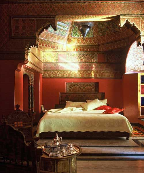 Moroccan Bedroom. Love the detailed architectural bed dome..