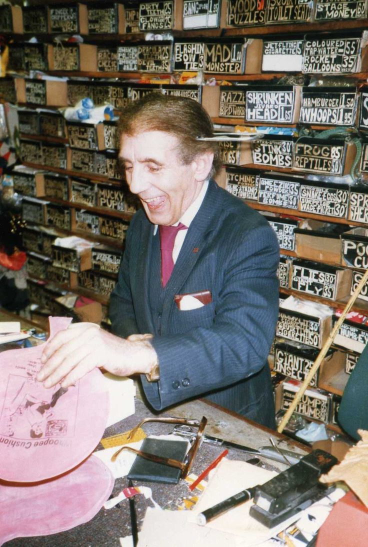 My magic mentor Alan Alan selling a whoopy cushion, with a giant safety pin through his head, in his shop 'Alan Alan's Magic Spot'.  I took this photo, I think, in 1983?  Alan would close his shop at 1230 on Saturdays and Michael Vincent and I would go to his apartment for and afternoon of sandwiches, videos and talk of magic.