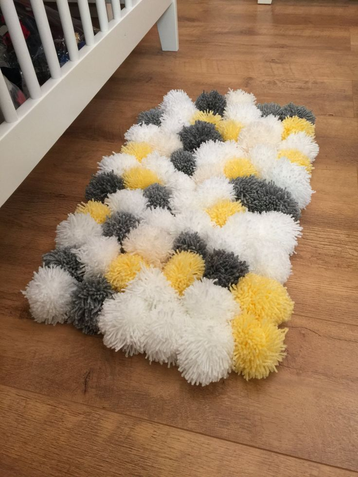 Gorgeous fluffy pom pom rug perfect for a nursery to keep feet warm and cosy when soothing baby