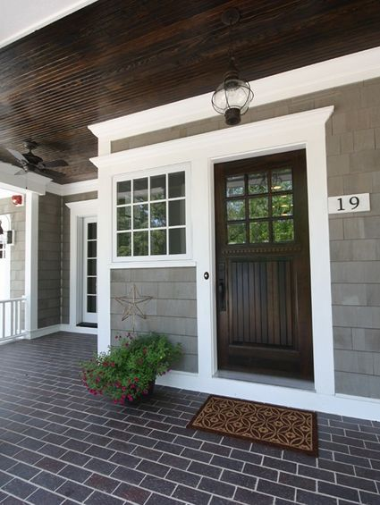 dark wood front door, gray house, white trim