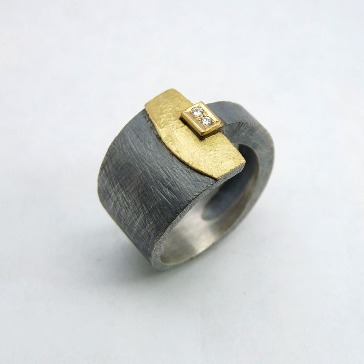 Ring made out of silver, 18k yellow gold & two brilliant-cut diamonds