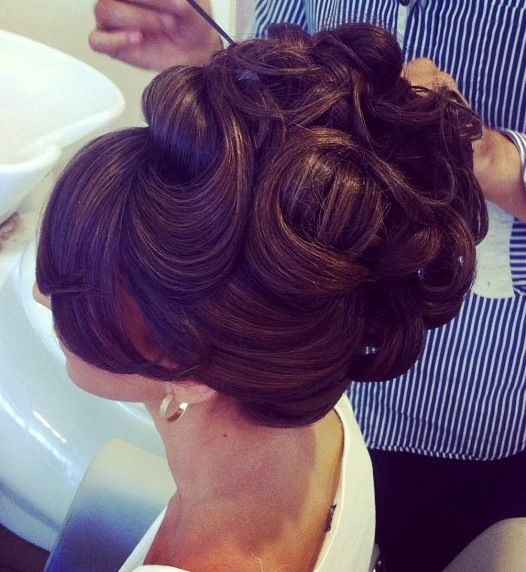 A gorgeous, full-body, high and intricate bridal updo