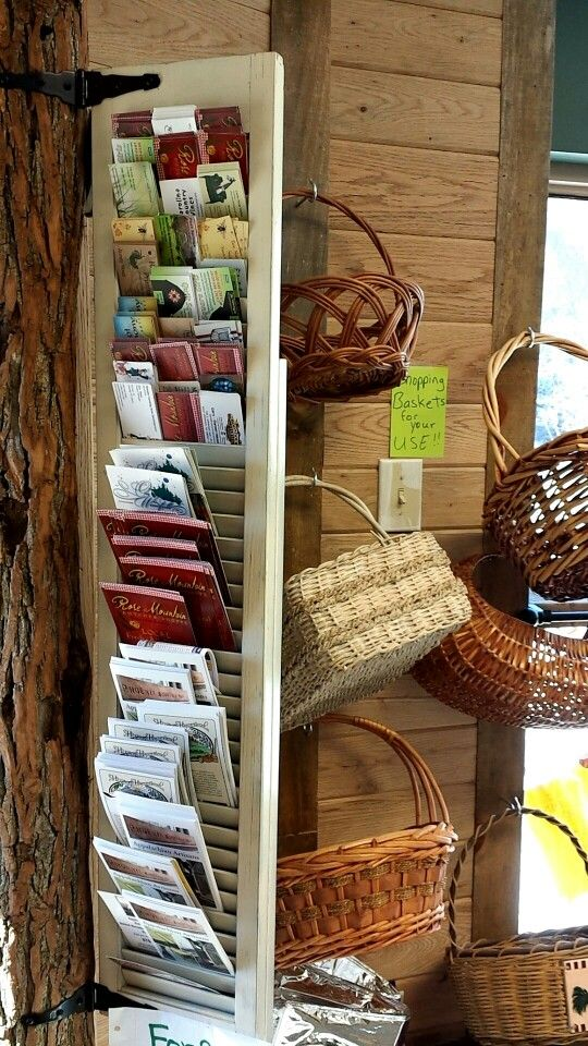 Business card and brochure holder made from old shutter. Old baskets for shopping carts instead of plastic.