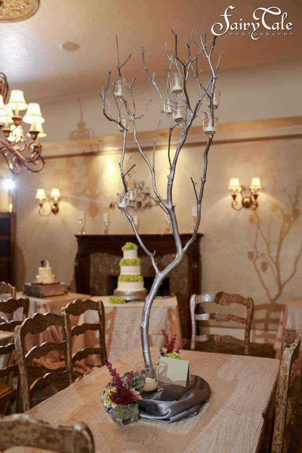 Tall branch wedding centerpieces with candles at Wildwood Inn in Denton. Laura and Justin's Real Wedding Texas. Fairy Tale Wedding Photography. #weddingwishes