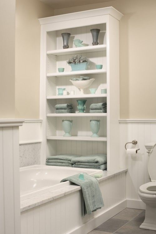 Bathroom Organization Ideas/ Create added storage by using the space at the  end of the bathtub for built in shelving.