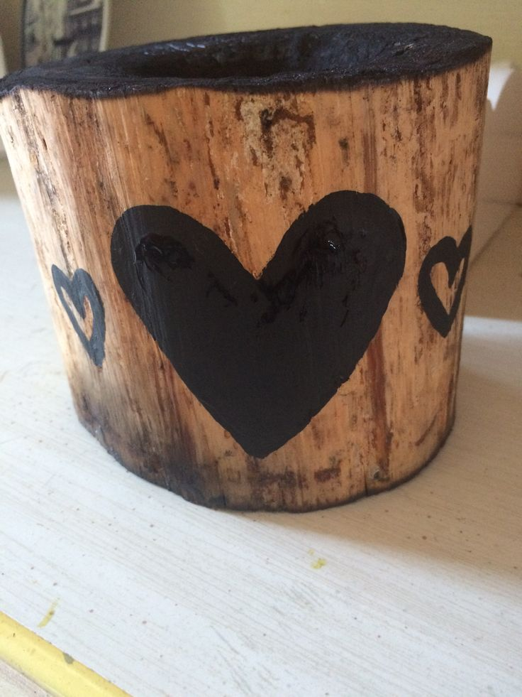 Easy rustic jewelry holder for a bathroom or kitchen. Just saw the end off a log, strip bark, smooth, torch top and bottom including hole in top, paint and seal.