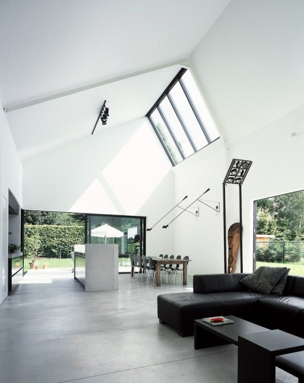 A black saw toothed factory roof building with a bright white interior was the starting point for this amazing Belgian house by architect Pascal Francois.