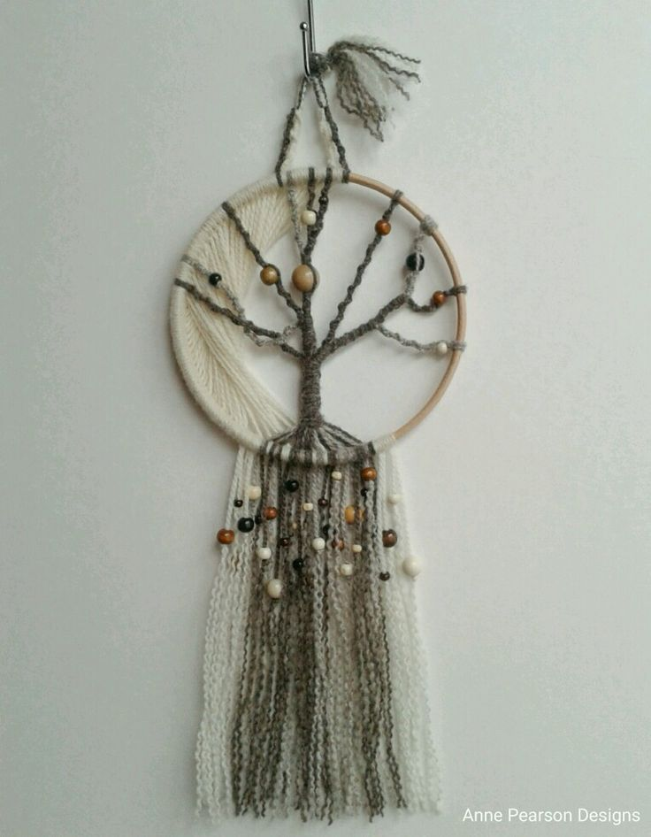 "Winter Moon, macramé fibre art reamcatcher/wall hanging. Knotted around a 7"" beech hoop in mill spun wool with a variety of different colour & size wood beads. www.facebook.com/AnnePearsonDesigns AnnePearsonDesigns.tictail.com #macramé #treeoflife #handcrafted #fibreart #fibreart #wallhanging"