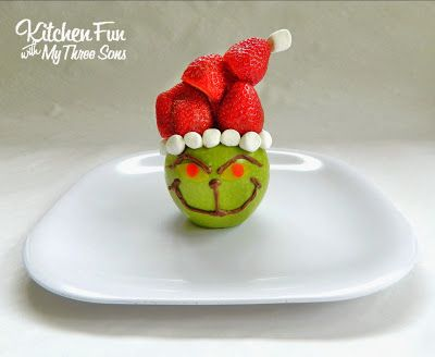 The Grinch Made Out Of Fruit For A Fun Christmas Snack That Kids Will Love An Event Could Surround With Cut Strawberries And Apple Slices