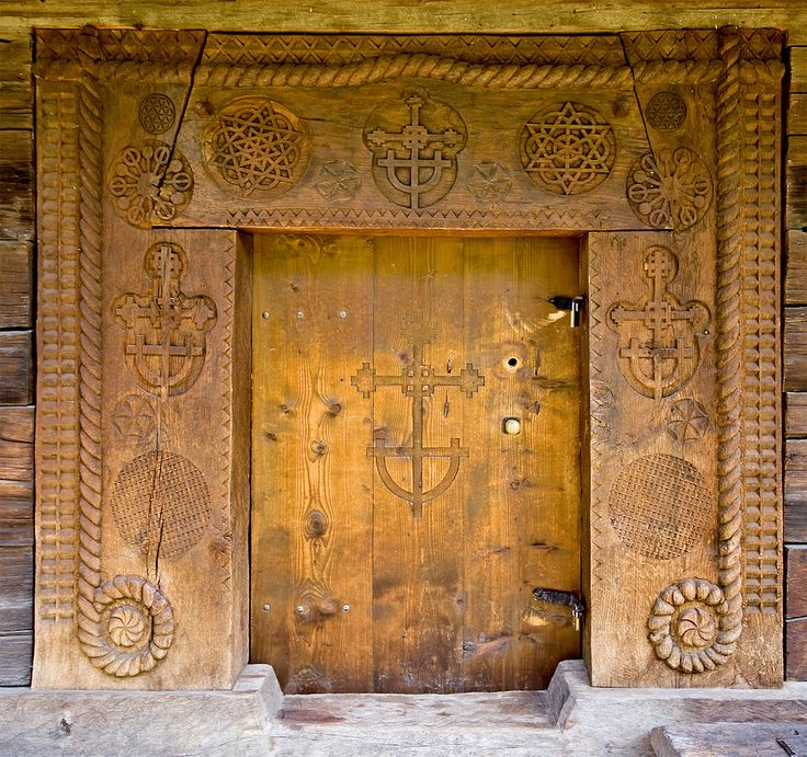 Entrance of the wooden church from Budești Josani, Maramureș, Romania