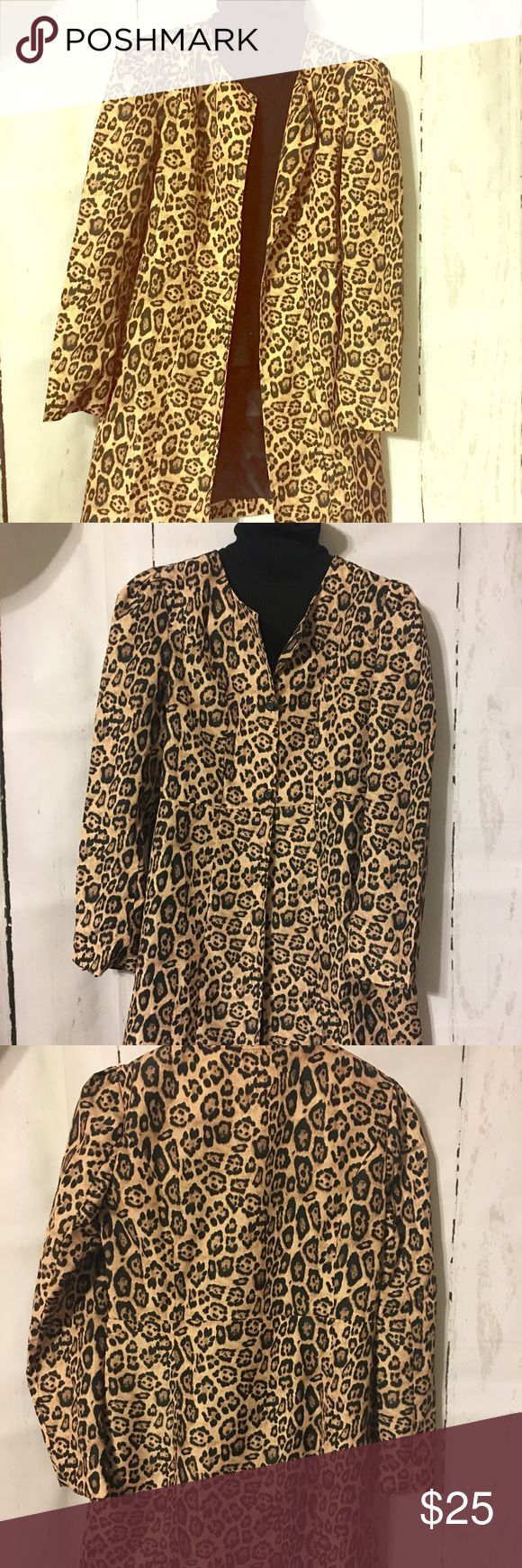 Cheetah Print Topper Cheetah Print Topper. No tag but it feels like polyester nylon, almost like a light raincoat so possibly water repellent. Sized XL but runs small so better fit for a 10-12. Perfect over a black body Con dress (see my closet) or on top of jeans and t-shirt. Jackets & Coats Trench Coats