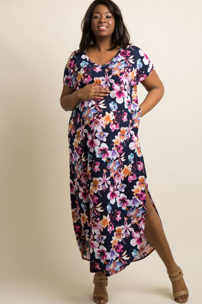 344cb5c3fe3 A floral print plus size maternity maxi dress featuring short dolman sleeves  with twisted cuffs and