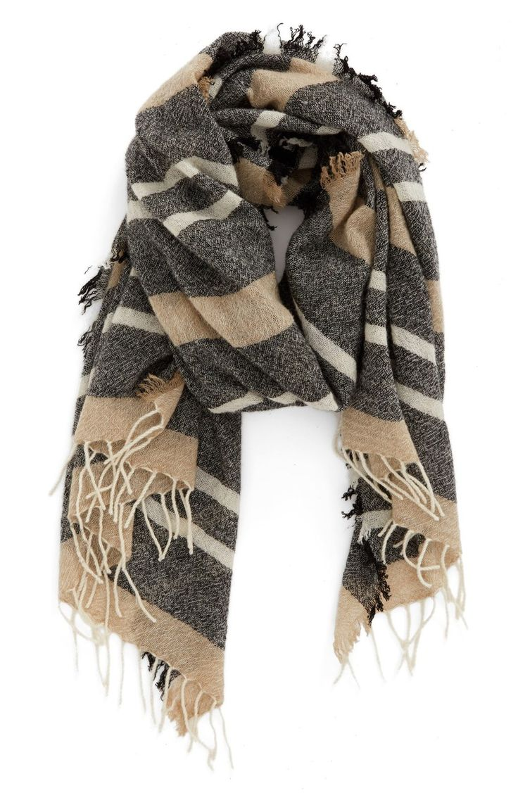 Soft fringe extends the cozy appeal of this wool scarf in a neutral stripe pattern.