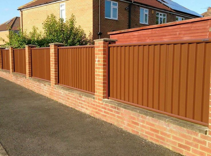 Plain Brown Colourfence Between Brick Pillars Fence