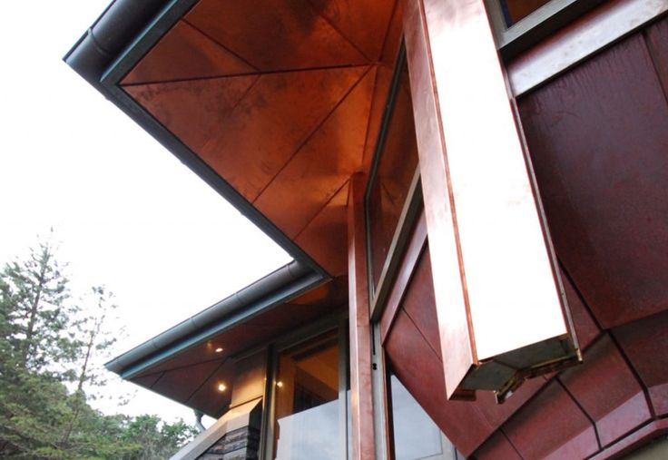 Byron Bay Residence NSW Double standing seam roof, copper V25 soffit cladding and copper rain water goods. Classis Copper.