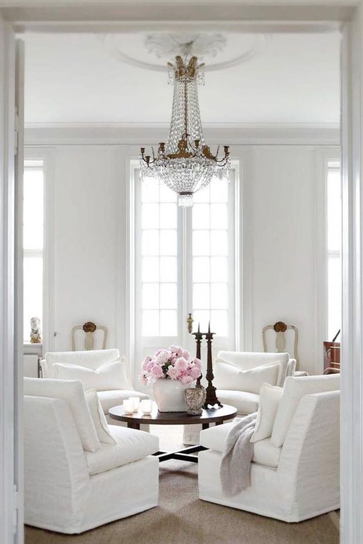 French Style Living Room With White Linen Slip Covers On Four Arm Chairs Whi
