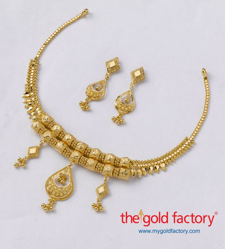 Chunky pieces, ball chokhas and varied pendants make for an eclectic ensemble in this rustic lightweight necklace. Handcrafted in hallmarked 22K gold, with matching earrings that follow the centrepiece, a set of ornaments that's very, very Gold Factory.   Necklace weight 18gms and Price Rs.57,450/- Earring weight 4 gms and Price Rs.12,800/-