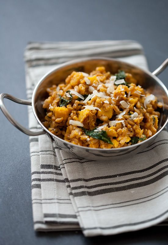 Farro Risotto with Acorn Squash and Kale. To cut down on clean up, toast farro in the pot after cooking the onion and garlic and steam the kale with the vegetable stock. Could use a bit more spice - sage or thyme, perhaps?
