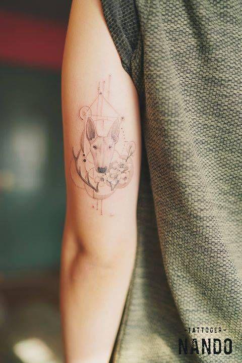 Fine line bull terrier tattoo on the left back of the arm....