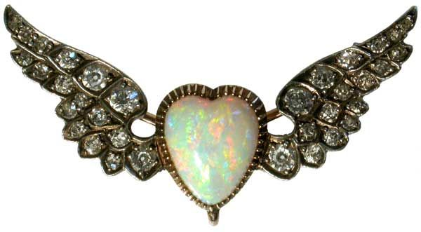A Victorian opal and diamond brooch formed as a winged heart ~ Set in silver and gold.