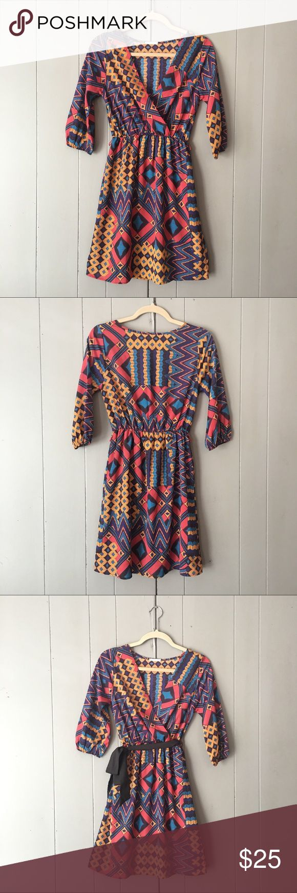 "✨Sale✨Beautiful Tribal Print Dress🍃LIKE NEW🍃 Gorgeous bold colored dress in like new condition! Brand is Everly and dress was purchased from Nordstrom. Skirt is lined. 100% Polyester. Bust is 30"" (armpit to armpit 15""). Length is 35"". Elastic at the waist. Nordstrom Dresses"