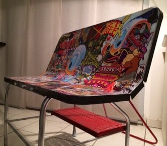 Bench Made From An Old Road Sign Redecorated With Upcycled Magazine Comic Book
