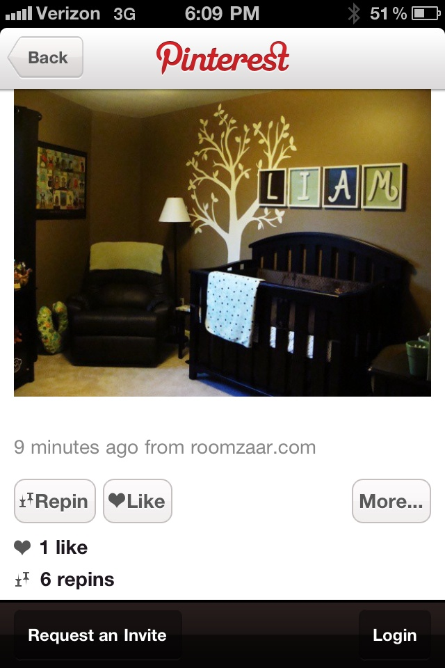 like the wall with the white tree painted on the darker wall and then the framed letters of his name