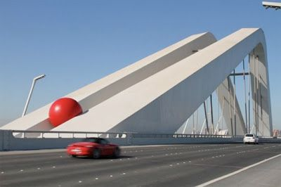 For the past six years, artist Kurt Perschke has squeezed a huge red ball into cracks, gaps and alleys all around the world. The red ball has visited cities like Barcelona, Chicago, Toronto and Sydney, and it's now heading to England